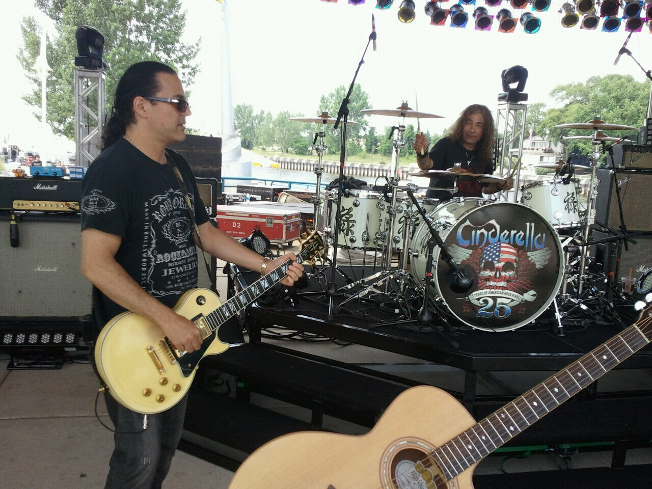 During soundcheck on the Cinderella 25th anniversary tour, we decided to switch instruments, and jam a little AC/DC. That's (Drummer) Fred Coury on guitar, and Gary Corbett playing the drums.